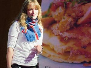 Person framför presentation om mat