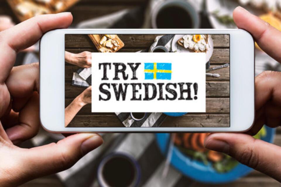 Mobiltelefon med Try Swedish logga